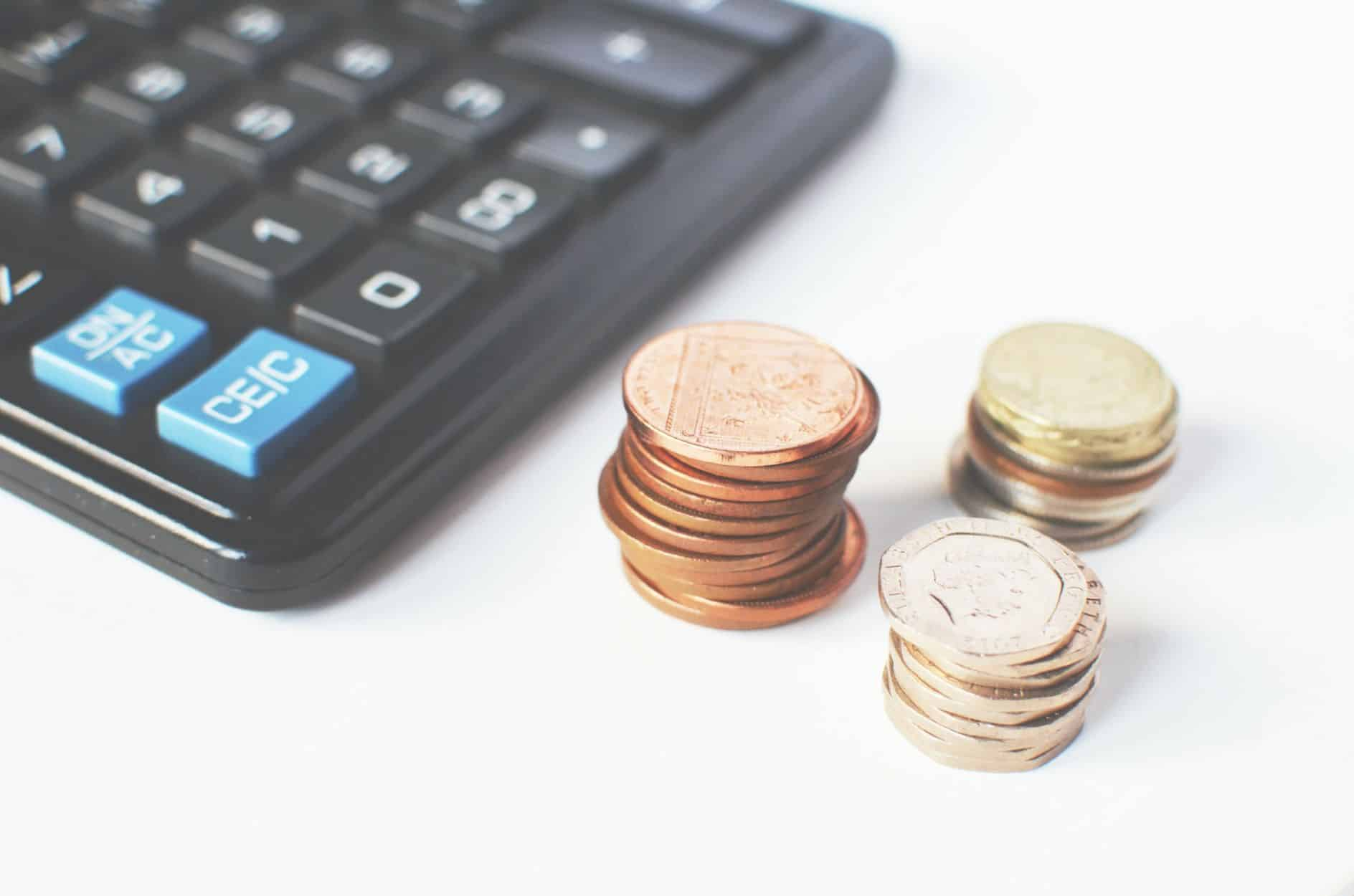 Los Angeles real estate blog - Coins next to a calculator